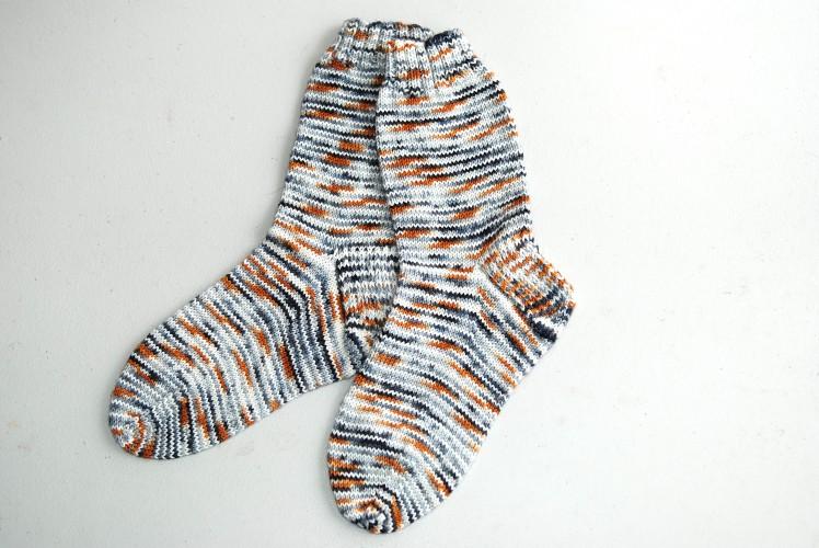 A pair of socks knit in Merino Nylon yarn in the Australian Shepherd colourway.