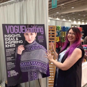 Caroline with the cover of Vogue Knitting featuring our yarn!