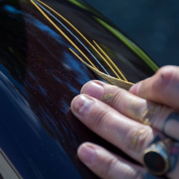 The swankiest photo I have of me pinstriping. Photo by Crystal Roman